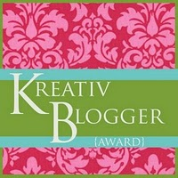 A pink, green, and blue patterned background. Writing says Krativ Blogger Award.