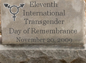Superimposed on a tombstone are the words 'Eleventh International Transgender Day of Remembrance November 20, 2009'. There is a trans symbol in the top left corner.