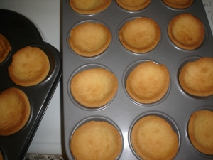 Small circles of pastry in trays.