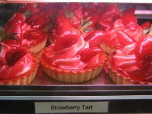 A bunch of strawberry tarts.