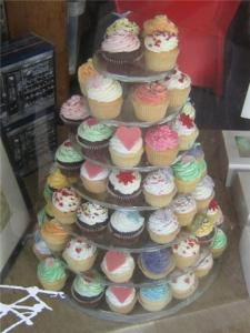 A tower of many different kinds of cupcakes.