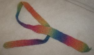 A tie knitted in rainbow wool.