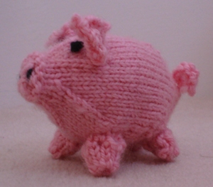 A pink knitted pig.